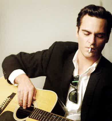 Joaquin Phoenix as American blues singer Johnny Cash in Walk the Line, 2005. Photograph by 20th Century Fox Film Corp.