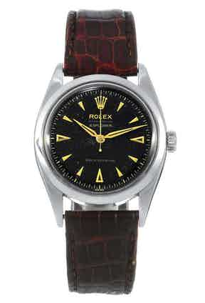 Rolex Explorer ref. 6298 with black dial. Both 6298 and 6098 featured characteristically 1950s Rolex Oyster dials with closed minute track, applied arrow hour markers and applied Rolex coronet.