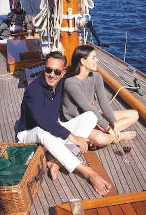 On Alexander: Navy cotton long-sleeved sartorial polo shirt, ecru cotton Riviera trousers, all Alexander Kraft Monte Carlo.On Zoé: grey pure summer cashmere ladies crewneck sweater, Alexander Kraft Monte Carlo