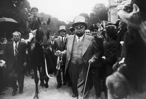 Aga Khan III and his horse at Longchamp, 1948
