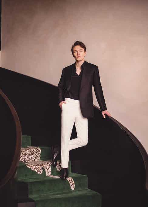 Black line jacket and black silk shirt, Edward Sexton; white trousers, Alexander Kraft Monte Carlo at The Rake; black calf Chelsea boots, George Cleverley