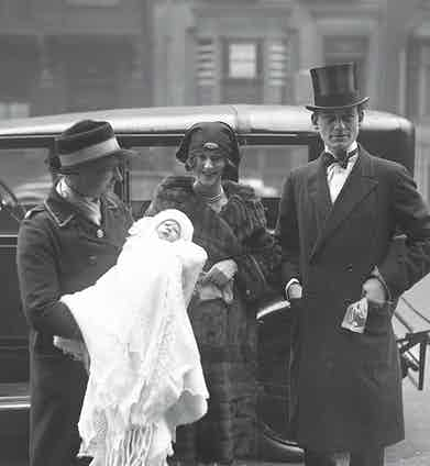 Lord and Lady Glenconner arrive with their son Colin for his christening in London