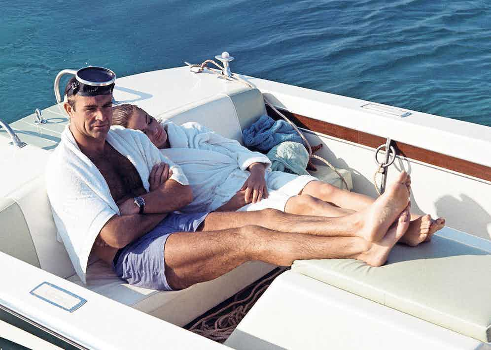 Sean Connery and Claudine Auger relaxing between takes whilst filming Thunderball in 1965.