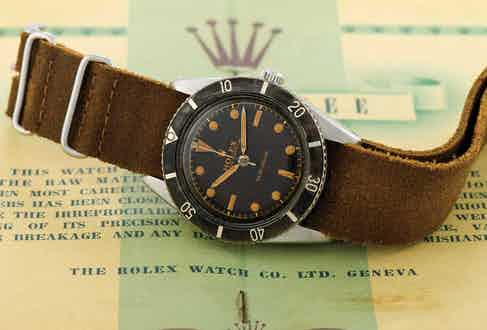 Rolex-Submariner reference 6204 was the very first dive watch to be rated to a depth of 100 metres. The watch had a highly legible dial layout, with hands that like the painted hour hands were filled with Radium. Image: Antiquorum