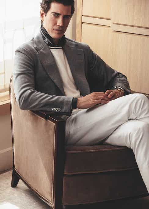 Montmartre: Grey jersey jacket with patch pockets; white cotton trousers; white with charcoal bands wool and cashmere sweater; charcoal and white Indian pattern scarf; Historiques American 1921, Vacheron Constantin.