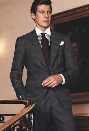 Vendôme: Grey Glen check peak-lapel single-breasted suit; purple cotton striped contrast-collar shirt; purple silk textured tie; and white cotton pocket-square.