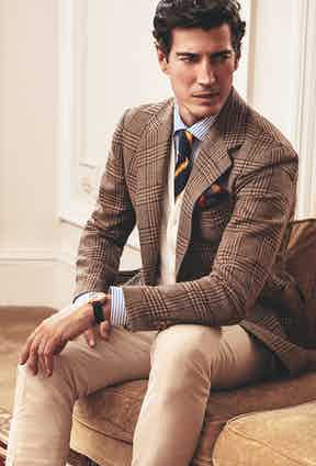 Sorbonne: Brown check wool and silk jacket with patch pockets; cream moleskin trousers; cream knitted wool and cashmere waistcoat; laguna blue cotton striped shirt; navy and yellow regimental silk tie; Historiques American 1921, Vacheron Constantin.