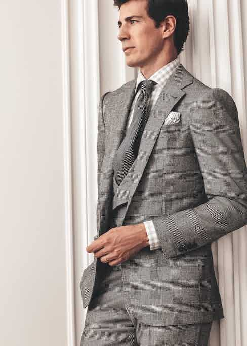 Iconic III: Black/grey Glen check single-breasted three-piece suit; light grey gingham cotton shirt; mid-grey textured tie