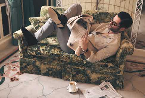 White and blue Japanese selvedge cotton striped shirt, Barbanera at The Rake; grey wool trousers, Anderson & Sheppard; brown cotton socks, London Sock Company; black suede loafers, Baudoin & Lange at The Rake; brown tortoise optical glasses, Cutler & Gross; Villeret Complete Calendar with blue dial and navy leather strap, Blancpain