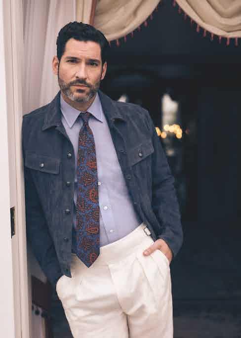 Navy suede jacket and cream linen Gurkha trouser, both Ralph Lauren Purple Label; light blue linen shirt and blue silk paisley print tie, both Budd Shirtmakers