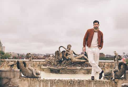 Burnt orange bomber jacket, Valstar; white cashmere jumper and white line trousers, both Ralph Lauren; beige and white linen polkadot scarf, Anderson & Sheppard; brown calf leather boots, George Cleverley at The Rake; brown tortoise sunglasses, Cutler & Gross