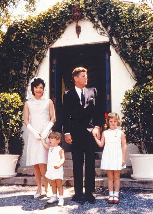 Kennedy with his wife, Jacqueline, and their children, Caroline and John Jr. on Easter Sunday in Miami, 1963 (Photo by MPI/Getty Images)