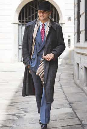 LOOK 3: Denim-coloured worsted wool double-breasted suit; raglan-sleeved overcoat in Donegal tweed.