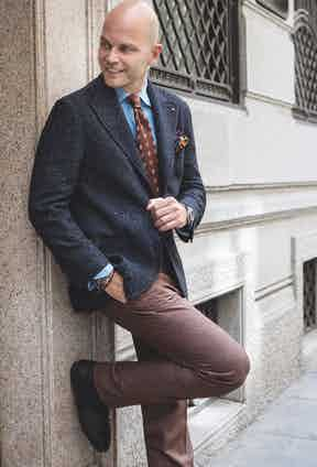 LOOK 4: Cobalt-blue single-breasted Donegal tweed blazer; grey-brown iconic Rubinacci Ulster coat.