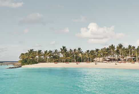 The new Patina resort sits on land in a private atoll that was reclaimed using the lowest-impact methods.