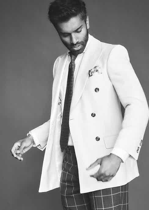 Cream linen double-breasted jacket, New & Lingwood; brown wool windowpane trousers, Stile Latino; mustard silk twill geometric print tie and ivory waterseller silk pocket-square, both Rubinacci. Hutch frames, E.B. Meyrowitz.