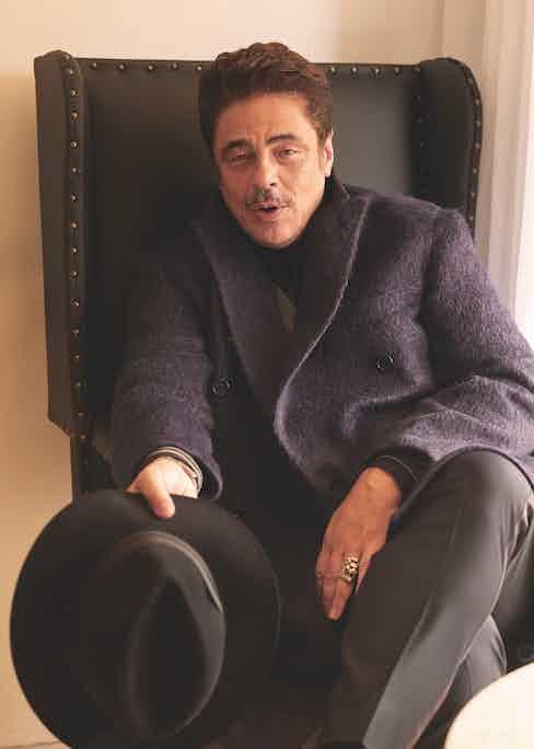 Double-breasted overcoat, Brioni; grey cardigan, Brunello Cucinelli; trousers, Giorgio Armani; black fedora with grey ribbon, Borsalino