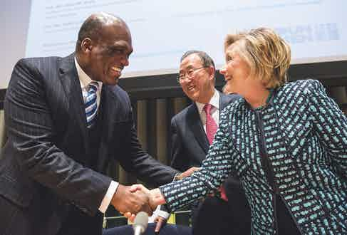 John Ashe greets Hillary Clinton at the United Nations in 2014 (Photo by Andrew Burton/Getty Images)