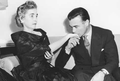 Rubirosa kissing the hand of an indifferent Barbara Hutton at their wedding reception in Paris, 1953. Their marriage lasted 53 days. (Photo by Hulton Archive/Getty Images)