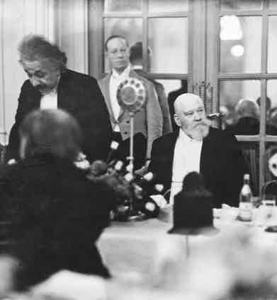 At a gala at the Savoy Hotel, flanked by Albert Einstein and George Bernard Shaw