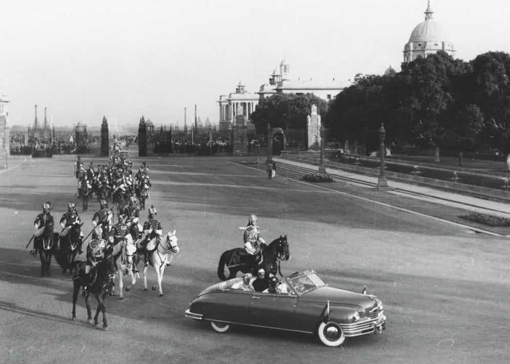The Yugoslavian president, Marshal Josip Broz Tito, with Nehru and President Rajendra Prasad in a state car escorted by a guard of honour, as they arrive at Rashtrapati Bhawan, New Delhi, in December 1954 (Photo by Keystone/Hulton Archive/Getty Images)