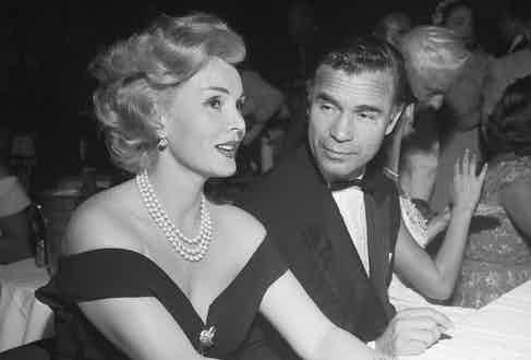 Porfirio Rubirosa turns on the charm with Zsa Zsa Gabor at the Mocambo nightclub in Los Angeles, 1954 (Photo by Earl Leaf/Michael Ochs Archives/Getty Images)