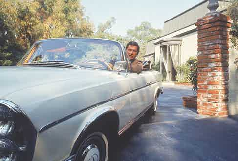 Robert Evans driving from his home. (Photo by Alfred Eisenstaedt/The LIFE Picture Collection via Getty Images)