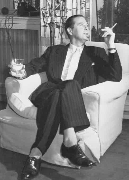 Terence Rattigan shows how to elegantly smoke a cigarette, 1956 (Photo by ANL/REX/Shutterstock (1391939a)