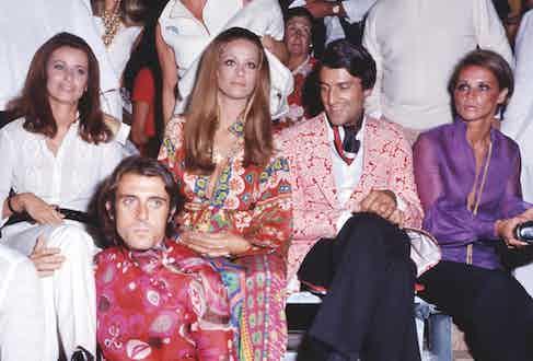 Gigi Rizzi with French actress Claudine Auger and designer Nino Cerruti, circa 1970 (Photo via Rex)