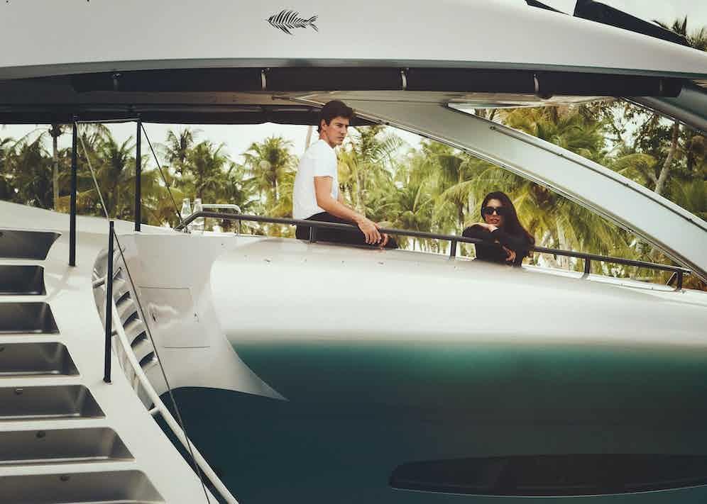 Amo: Long sleeve swimsuit, model's own; black tortoiseshell acetate Eric sunglasses, Tom Ford. Oriol: Black wool and mohair tuxedo trousers, Ralph Lauren; white Supima cotton T-Shirt, Cifonelli