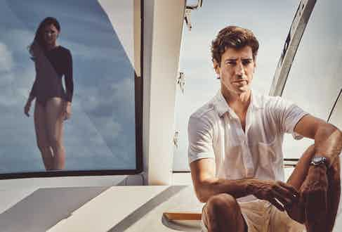 Amo: Long sleeve swimsuit, model's own. Oriol: White cotton polo shirt, Lorenzo Cifonelli x The Rake; off-white cotton shorts, Lorenzo Cifonelli x The Rake; 42mm Submersible PAM00683, Panerai.