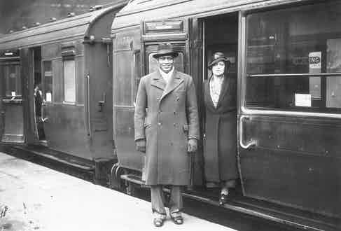 Paul Robeson and his wife, Eslanda leaving Waterloo station, London (Photo by H F Davis/Getty Images)