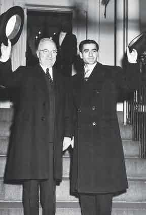 US President Harry S Truman and the Shah of Iran Mohammad Reza Pahlavi wave from steps of Blair House during the latter's state visit, Washington DC, 1949. (Photo by State Department/PhotoQuest/Getty Images)