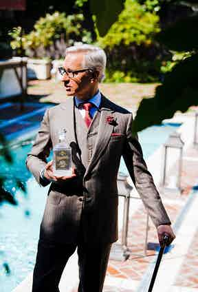 The great Paul Feig holding a bottle of his Artingstall's gin